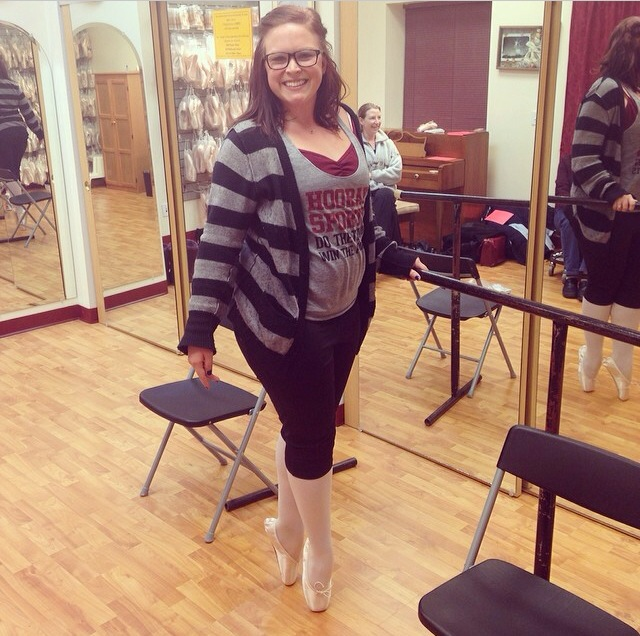 Posing in my first pointe shoes at my first pointe shoe fitting.